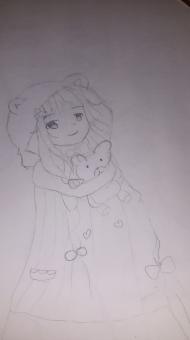 Teddy bear in a doll's hand